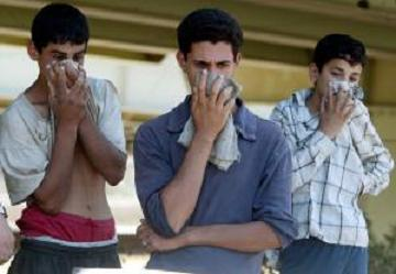 Three Iraqi youths cover their face beca